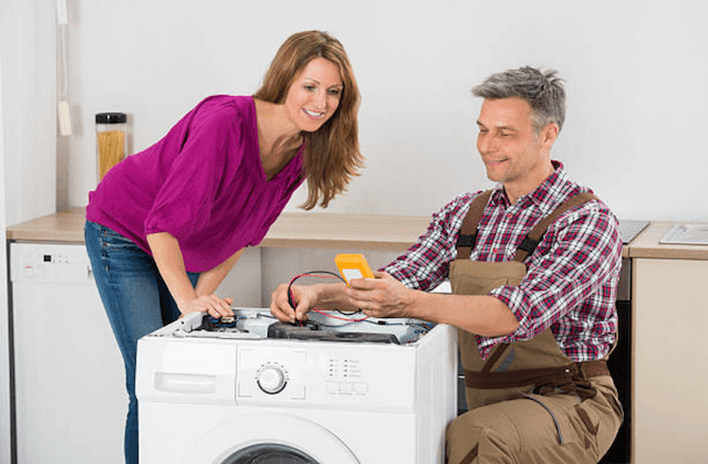 appliance repairman helping customer